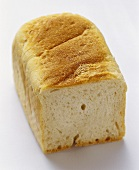 Partially Sliced Loaf of White Bread