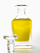 A Carafe of Oil with Stopper Removed
