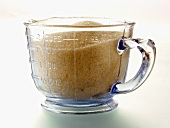 Brown Sugar Crystals in a Measuring Cup