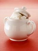 Sugar Cubes in a White Sugar Bowl; Lid