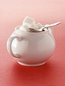Sugar Cubes in a White Sugar Bowl