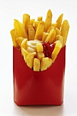 French Fries in Red Fast Food Box with Ketchup and Mayonnaise