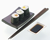 Assorted Maki Sushi with Chopsticks and Dipping Sauce