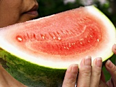 A Girl Holding a Slice of Watermelon