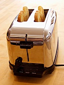 Two Slices of White Toast in a Toaster