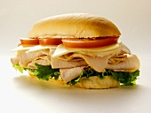 A Turkey Sub with Tomatoes, Cheese and Lettuce