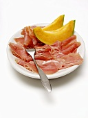 Sliced Procuitto and Melon on Plate with Fork