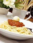 Bowl of Spaghetti with Meat Sauce; Topped with Butter