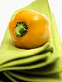 Yellow Bell Pepper Resting on a Green Cloth