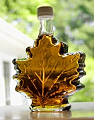 Maple Syrup in a Leaf Shaped Bottle; On Window Sill