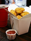 Chicken Nuggets in Fast-Food-Box; Ketchup; Cola
