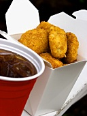 Chicken Nuggets in Fast-Food-Box; Cola