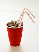 Cola in a Red Plastic Cup with Ice and Straws
