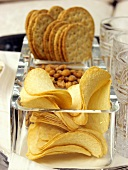 Cracker, Peanuts and Chips in Dishes