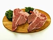 Two T-Bone Steaks on a Wooden Board