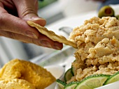 Dipping a Cracker into Shrimp Dip