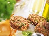 Raw lamb burgers with herbs