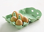 Five eggs in an egg box