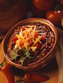 Bowl of Chili Topped with Salsa and Cheese