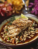 Grilled fish fillet on bean sauce