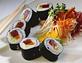 Sliced Sushi Roll with Veggies and Chopsticks