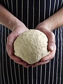 Hands Holding Ball of Dough