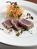 Grilled Sliced Tuna on a White Plate; Shredded Veggie Salad