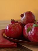 Whole Pomegranates in a Dish