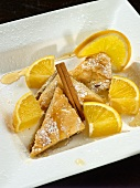 Baklava with Powdered Sugar, Orange, Honey and Cinnamon