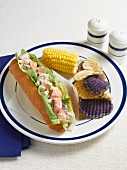 Lobster Roll with Potato Chips and Corn