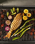 A Whole Snapper on the Grill with Lemons, Onions and Jalapenos