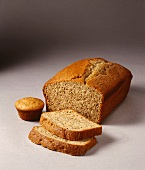 Partially Sliced Load of Banana Bread; Banana Muffin