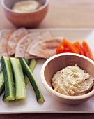 Bowl of Hummus with Vegetables and Pita Bread