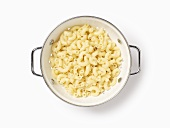 Cooked macaroni in a colander, seen from above