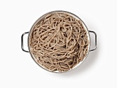 Cooked soba noodles in a colander, seen from above