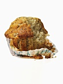 A lemon and poppyseed muffin with a bite taken out