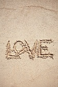 The word LOVE written in sand