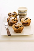 Berry muffins and a cup of milk