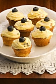 Passion fruit cupcakes with blueberries