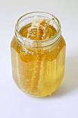 A honey comb in a jar of honey