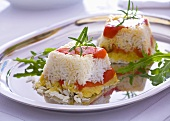 Rice timbales with fried peppers, rosemary and rocket