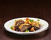 Stuffed venison steaks with melted cheese and chanterelle mushrooms