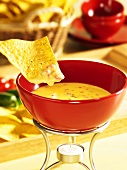 Cheese fondue with tortilla chips