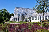 A large greenhouse in a park