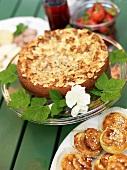 Almond cake and cinnamon buns on a garden table