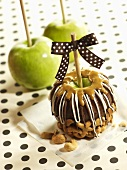 Granny Smith apples with caramel sauce, chocolate coating and cashews