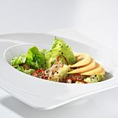 Green salad with papaya and Parmesan