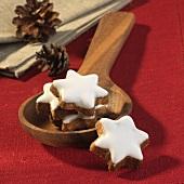 Cinnamon stars on a wooden spoon