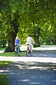 A couple cycling in a park