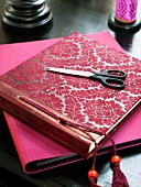 A photo album, scissors and a note book
